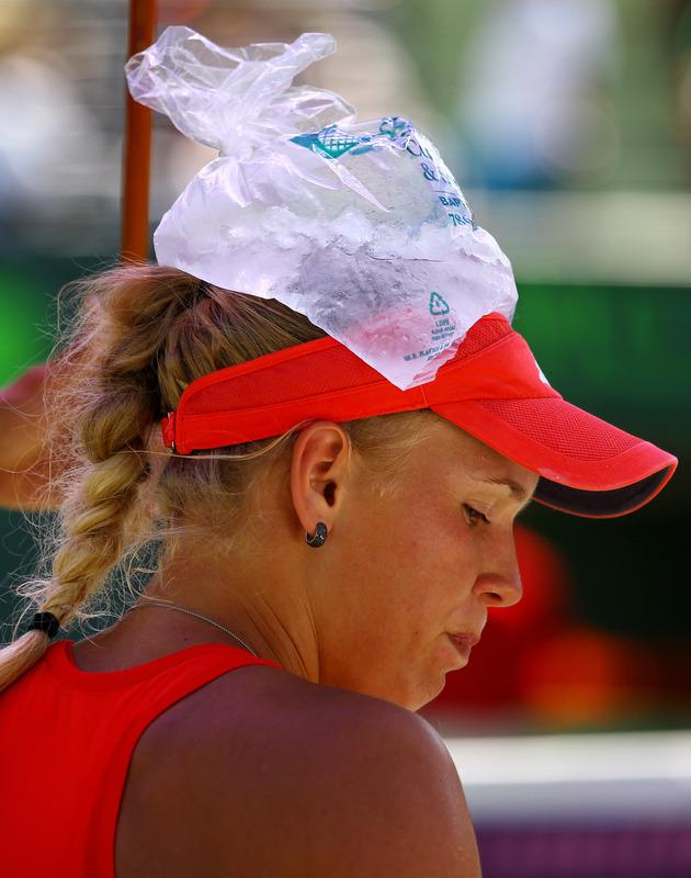 Caroline Wozniacki Of Denmark Sits