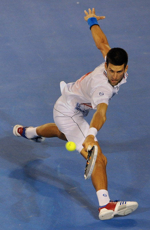 Novak Djokovic Of Serbia Hits