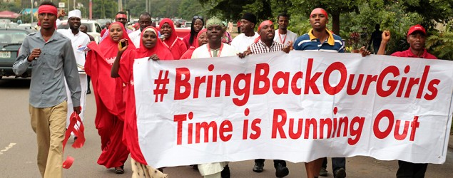 #BringBackOurGirls campaigners march during a rally. (Reuters)