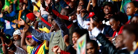 People sing and dance at First National Bank (FNB) Stadium ahead of a mass memorial for late former South African President Nelson Mandela in Johannesburg. (REUTERS/Yves Herman)