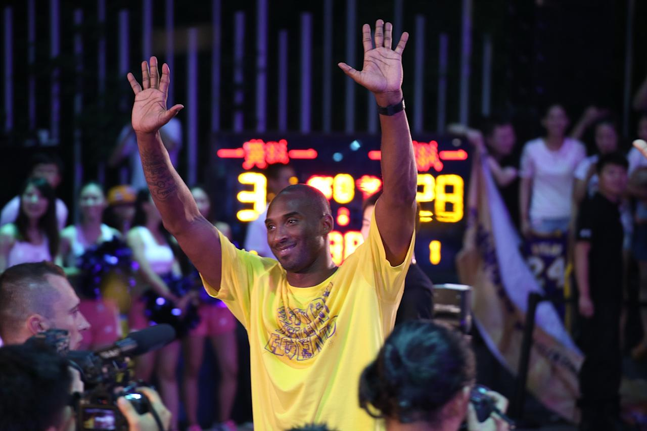 SHANGHAI, CHINA - AUGUST 08: (CHINA OUT) American professional basketball player Kobe Bryant of Los Angeles Lakers meets with fans during his Nike Tour in China on August 8, 2013 in Shanghai, China. (Photo by ChinaFotoPress/ChinaFotoPress via Getty Images)