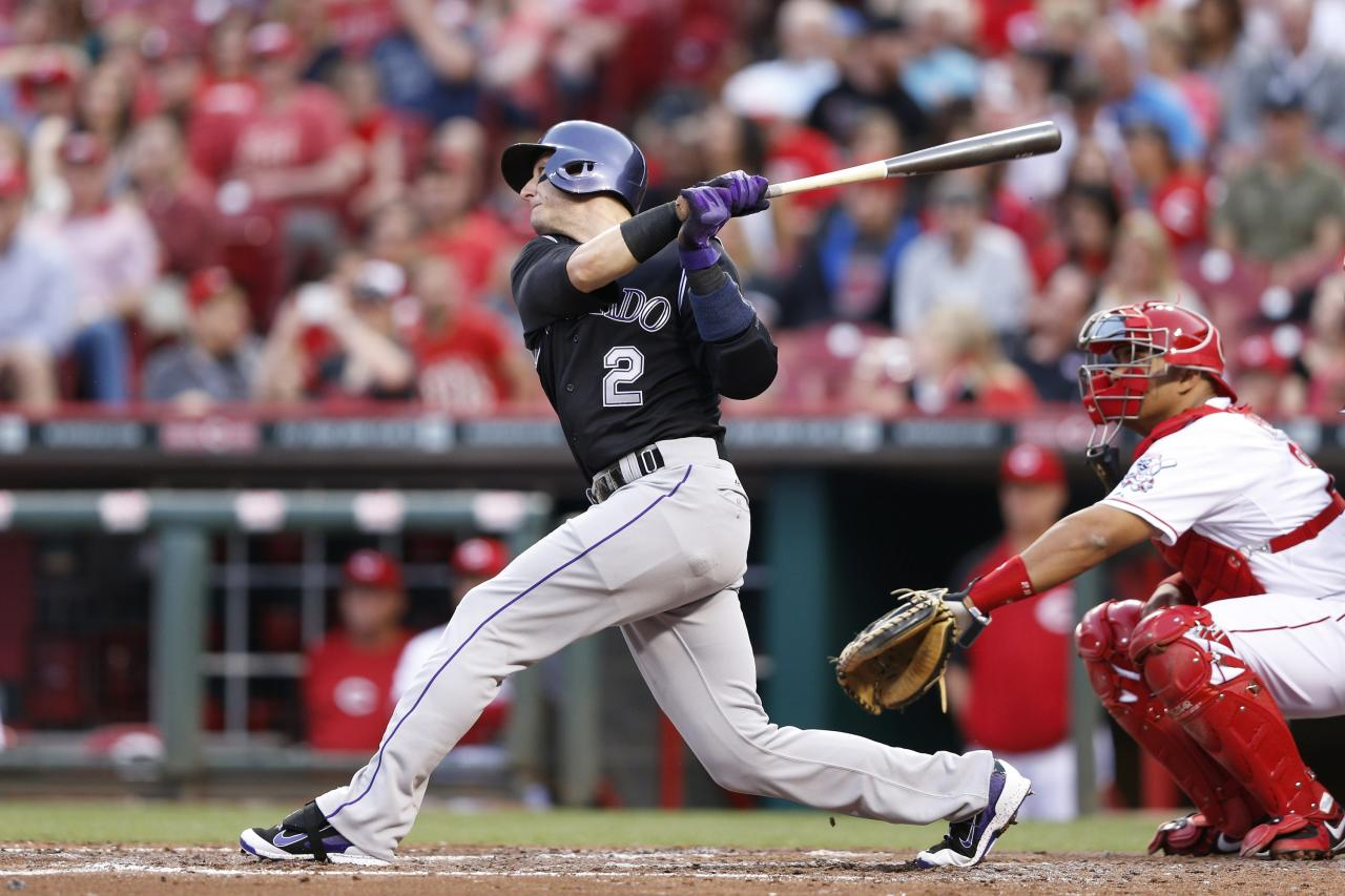 CINCINNATI, OH - MAY 9: Troy Tulowitzki #2 of the Colorado Rockies hits a home run in the top of the fourth inning of the game against the Cincinnati Reds at Great American Ball Park on May 9, 2014 in Cincinnati, Ohio. (Photo by Joe Robbins/Getty Images)