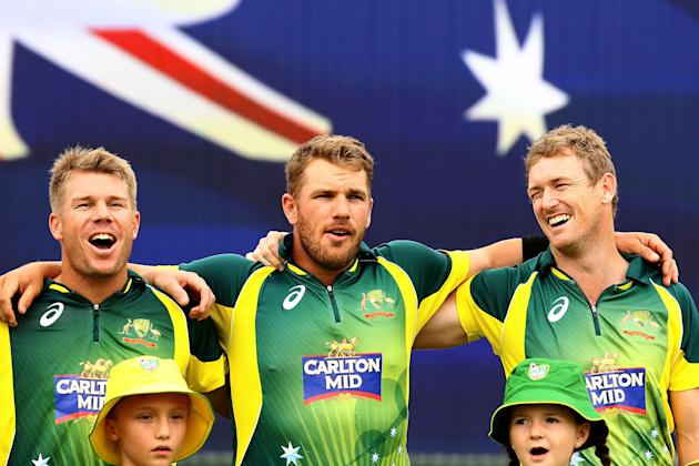 David Warner, Aaron Finch and George Bailey of Australia sing the Australian national anthem before the start of play. (Photo by Paul Kane/Getty Images)