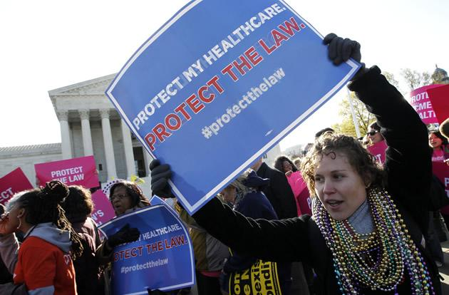 Lisa Dowling, from Arlington, Va., a supporter of health care reform, rallies in front of the Supreme Court.