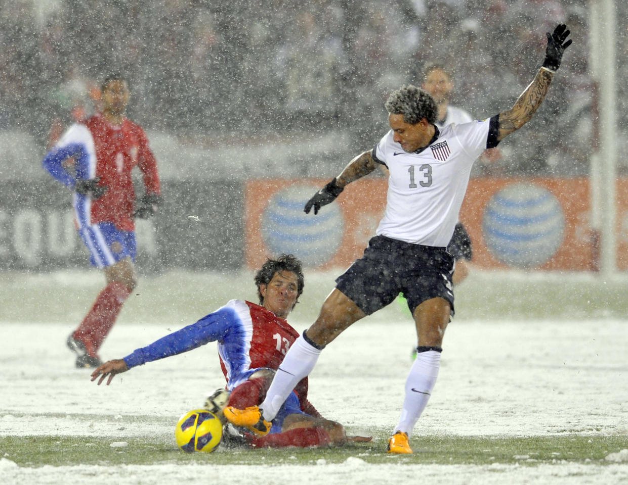 Costa Rica midfielder Ariel Rodgriguez, front left, tackles United States midfielder Jermaine Jones, right, during the first half of a World Cup qualifier soccer match in Commerce City, Colo., Friday, March 22, 2013. (AP Photo/Jack Dempsey)