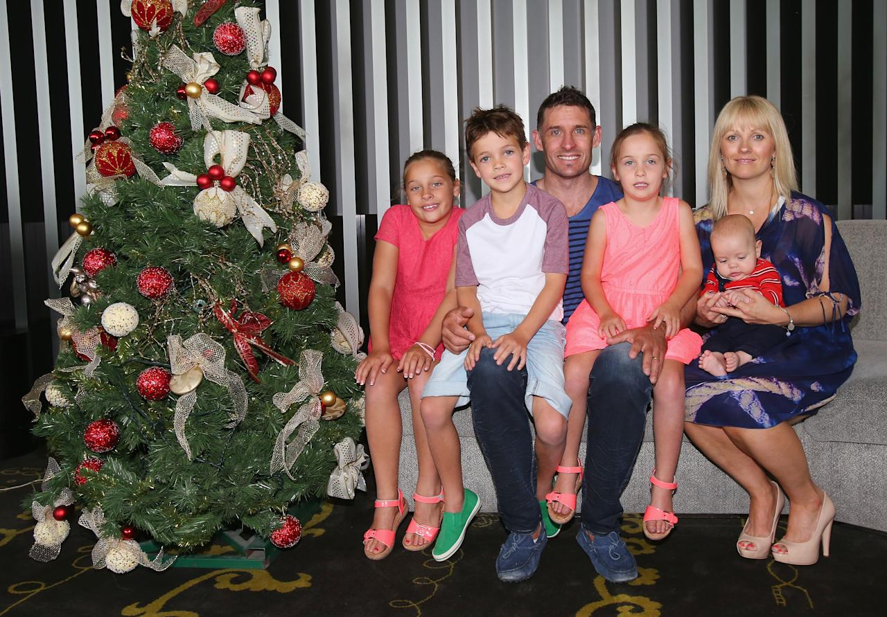 MELBOURNE, AUSTRALIA - DECEMBER 25:  Michael Hussey of Australia along with his wife Amy Hussey pose for a photo with their children (L to R) Molly, William, Jasmin and baby Oscar next to a Christmas tree ahead of a Cricket Australia Christmas Day lunch at Crown Entertainment Complex on December 25, 2012 in Melbourne, Australia.  (Photo by Scott Barbour/Getty Images)