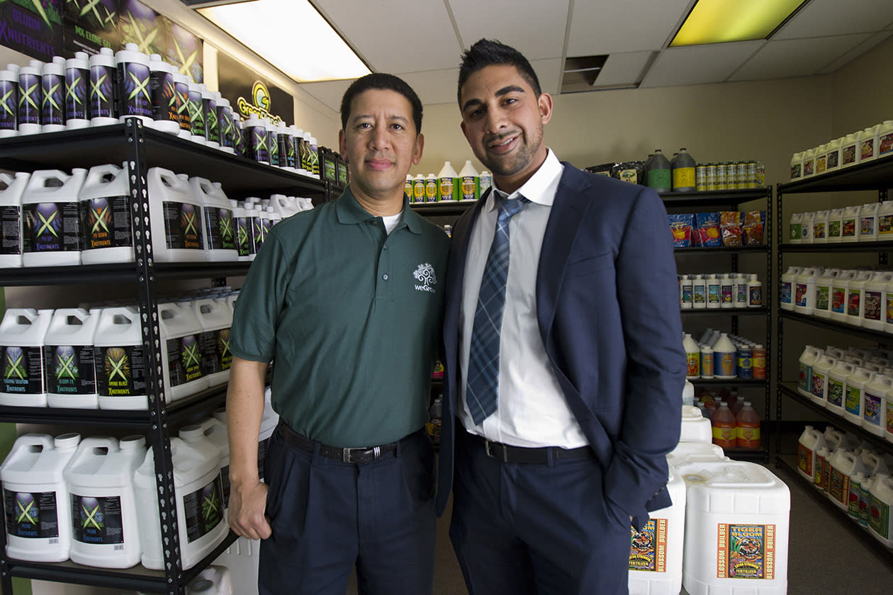 "WeGrow franchisee Alex Wong, left, and WeGrow founder Dhar Mann, right  pose inside the WeGrow store  in northeast Washington as they prepare for its opening. A company dubbed the ""Walmart of Weed"" is putting down roots in America's capital city, sprouting further debate on marijuana _ medical or otherwise. Just a few miles from the White House and federal buildings, a company that candidly caters to medical marijuana growers is opening up its first outlet on the East Coast. The opening of the weGrow store on Friday in Washington coincides with the first concrete step in implementing a city law allowing residents with certain medical conditions to purchase pot."