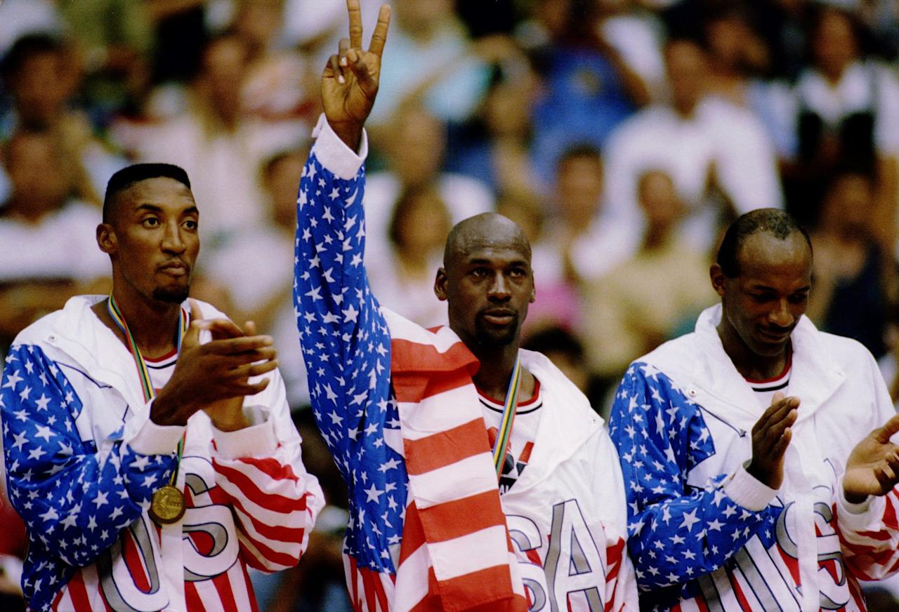 6 OCT 1992:  USA BASKETBALL TEAM MEMBERS MICHAEL JORDAN (MIDDLE) SCOTTIE PIPPEN (LEFT) AND CLIDE DREXLER (RIGHT) ACKNOWLEDGE THE CROWD AFTER RECEIVING THEIR GOLD MEDALAS MEMBERS OF THE DREAM TEAM DURING THE 1992 BARCELONA OLYMPICS IN BARCELONA, SPAIN. Man