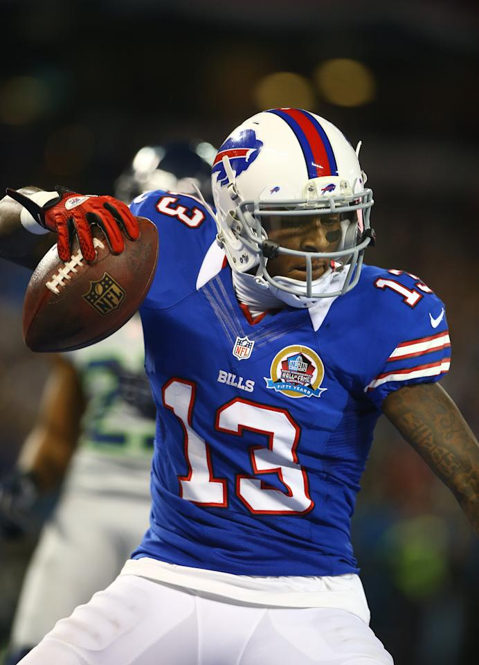 TORONTO, ON - DECEMBER 16: Stevie Johnson #13 of the Buffalo Bills spikes the football to celebrate his touchdown during an NFL game against the Seattle Seahawks at Rogers Centre on December 16, 2012 in Toronto, Ontario, Canada. (Photo by Tom Szczerbowski/Getty Images)