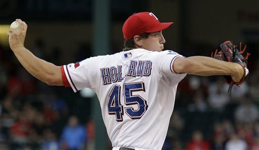 Holland, Rangers post 5-3 victory over Red Sox