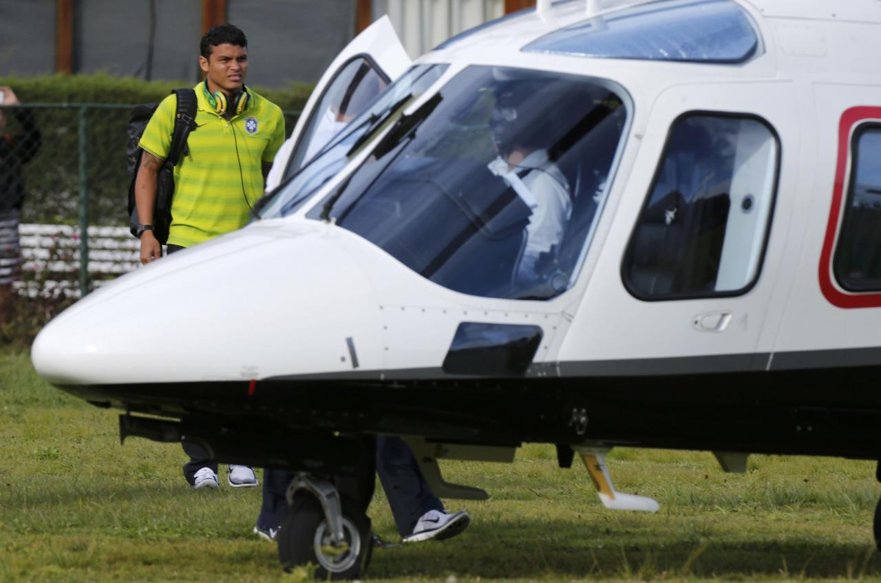 Brazil's Thiago Silva leaves the field and departs for the city of Belo Horizonte by helicopter after a training session in Teresopolis, near Rio de Janeiro, July 7, 2014. Brazil will meet Germany in their 2014 World Cup semi-finals on July 8.REUTERS/Stringer/Brazil (BRAZIL - Tags: SOCCER SPORT WORLD CUP)