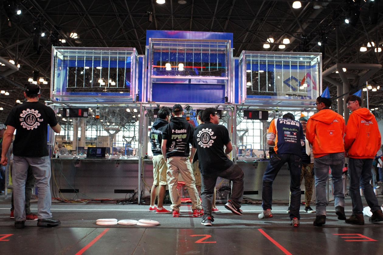 The Newtown High School robotic team started a little dance, as they wait to set up their control consoles for their next match in the elimination rounds.