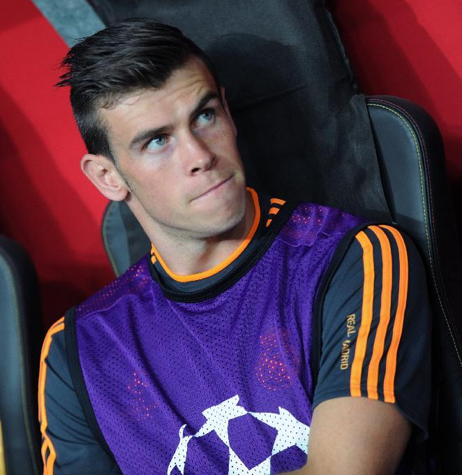 Real Madrid's Gareth Bale awaits the start of their Champions League Group B soccer match with Galatasaray in Istanbul, Turkey, Tuesday, Sept. 17, 2013. (AP Photo)