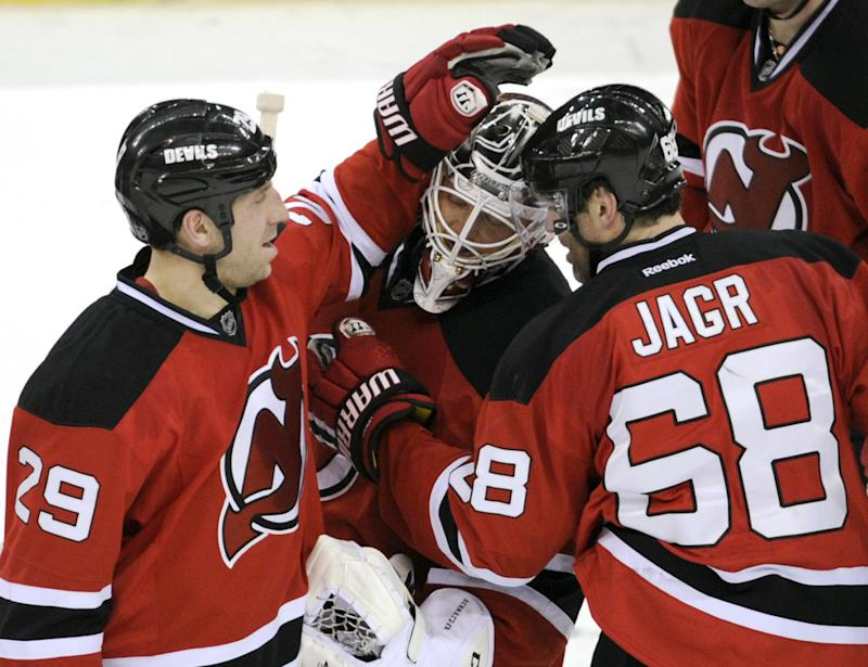 Merrill's 1st goal lifts Devils over Oilers in OT