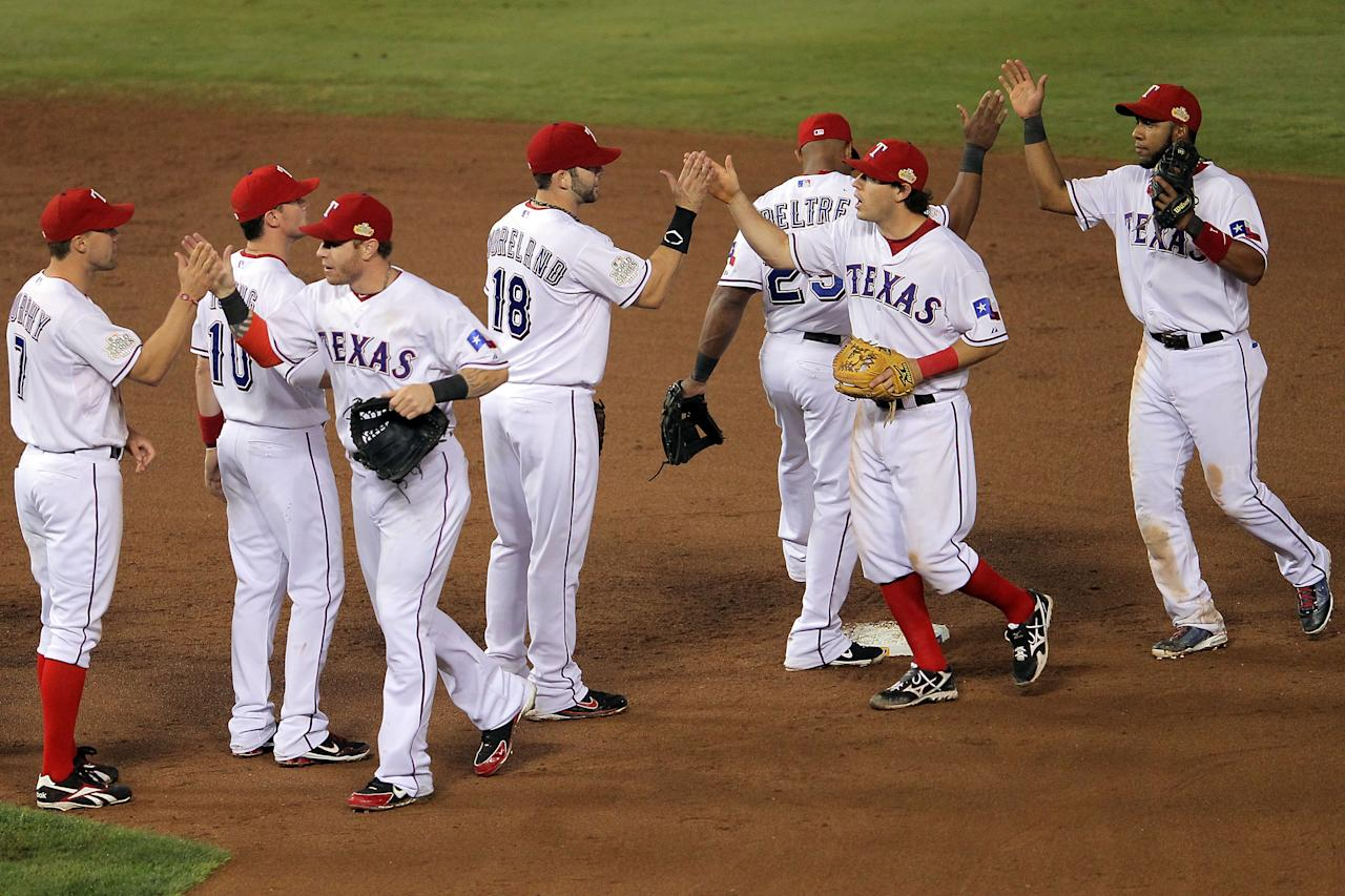 ARLINGTON, TX - OCTOBER 23:  The Texas Rangers celebrate after defeating the St. Louis Cardinals 4-0 in Game Four of the MLB World Series at Rangers Ballpark in Arlington on October 23, 2011 in Arlington, Texas.  (Photo by Doug Pensinger/Getty Images)
