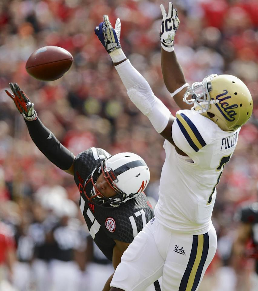 Nebraska cornerback Ciante Evans (17) breaks up a pass intended for UCLA wide receiver Devin Fuller (7) in the first half of an NCAA college football game in Lincoln, Neb., Saturday, Sept. 14, 2013. (AP Photo/Nati Harnik)