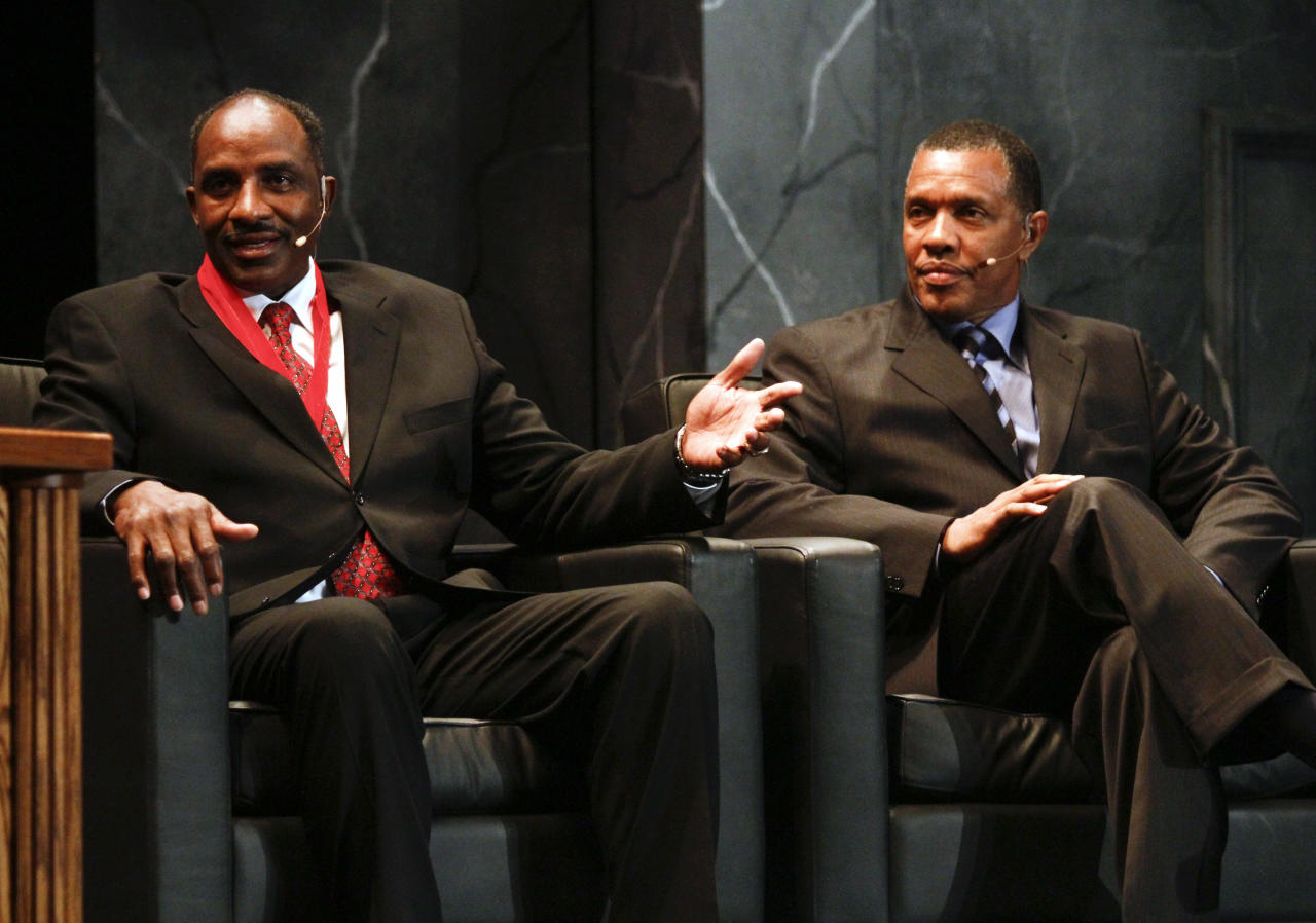Inductee David Thompson, left, speaks as Phoenix Suns' head coach Alvin Gentry looks on during the 2010 National Collegiate Basketball Hall of Fame induction ceremony, Sunday, Nov. 21, 2010, in Kansas City, Mo. Inductees include Wayne Duke, Christian Laettner, Tom Jarnstedt, Jerry West, Tex Winter, Sidney Wicks and Davey Whitney.