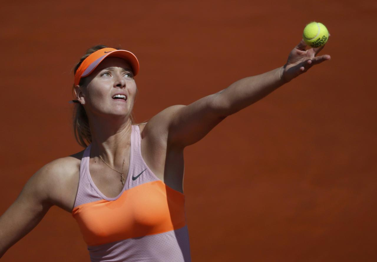 Maria Sharapova of Russia serves to Eugenie Bouchard of Canada during their women's semi-final match at the French Open tennis tournament at the Roland Garros stadium in Paris June 5, 2014. REUTERS/Gonzalo Fuentes (FRANCE - Tags: SPORT TENNIS)