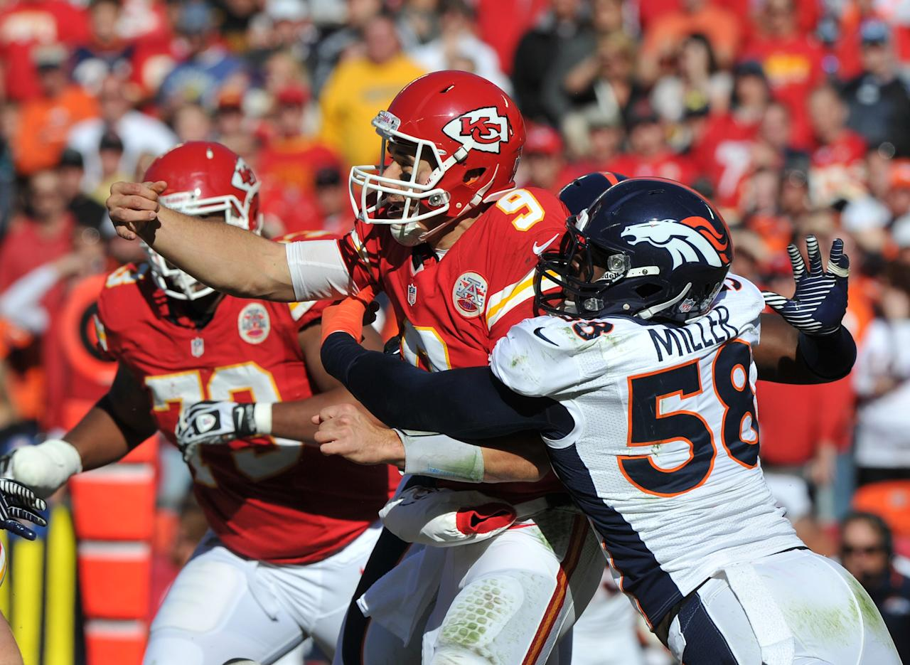 KANSAS CITY, MO - NOVEMBER 25:  Linebacker Von Miller #58 of the Denver Broncos pressures quarterback Brady Quinn #9 of the Kansas City Chiefs during the first half on November 25, 2012 at Arrowhead Stadium in Kansas City, Missouri.  (Photo by Peter Aiken/Getty Images)