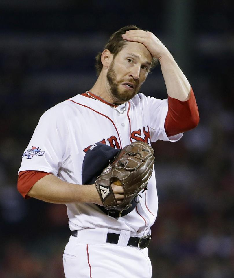 Boston Red Sox relief pitcher Craig Breslow reacts after a double hit by Detroit Tigers shortstop Jhonny Peralta in the eighth inning during Game 1 of the American League baseball championship series Saturday, Oct. 12, 2013, in Boston. (AP Photo/Matt Slocum)