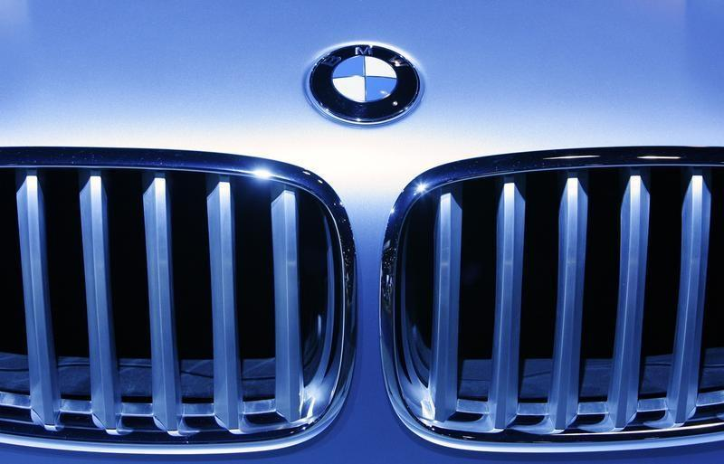 A BMW logo is illuminated on the grill of a car at the 2009 New York International Auto Show