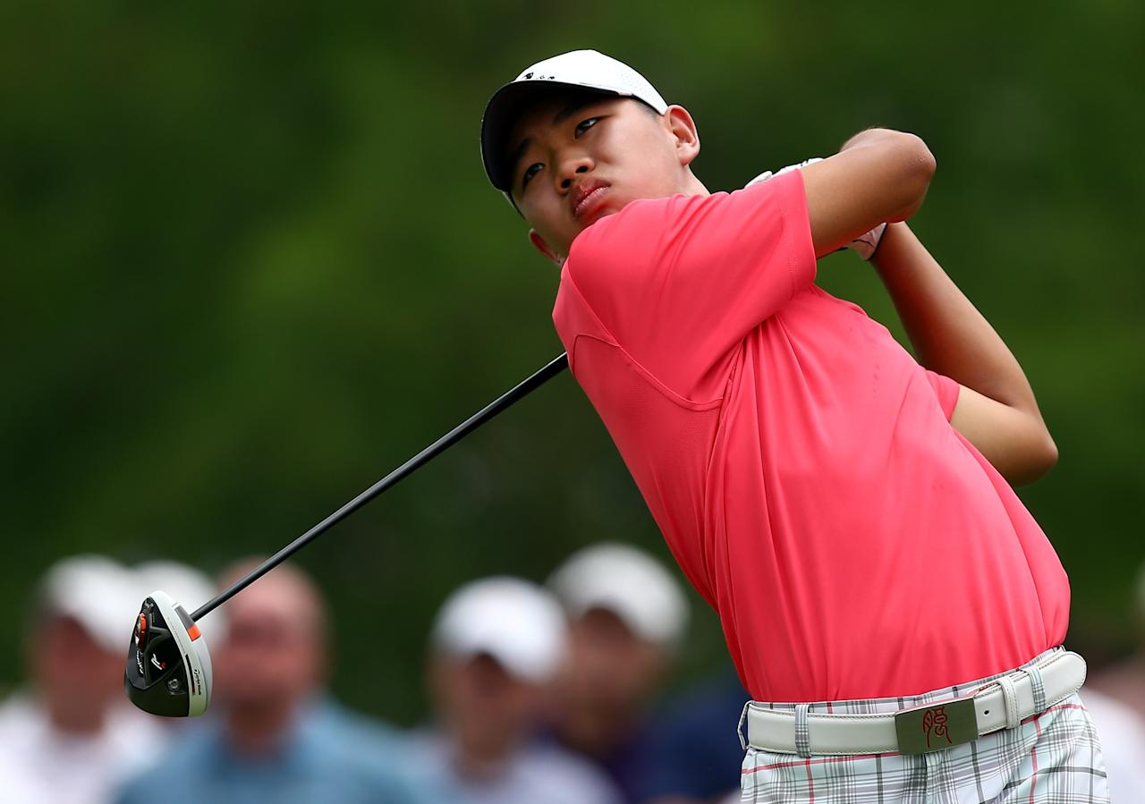 IRVING, TX - MAY 16: Guan Tianlang of China hits a shot during the first round of the 2013 HP Byron Nelson Championship at the TPC Four Seasons Resort on May 16, 2013 in Irving, Texas. (Photo by Tom Pennington/Getty Images)