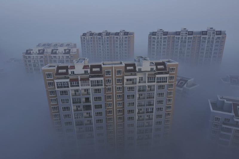 A residential compound is seen during a smoggy day in Wujiaqu