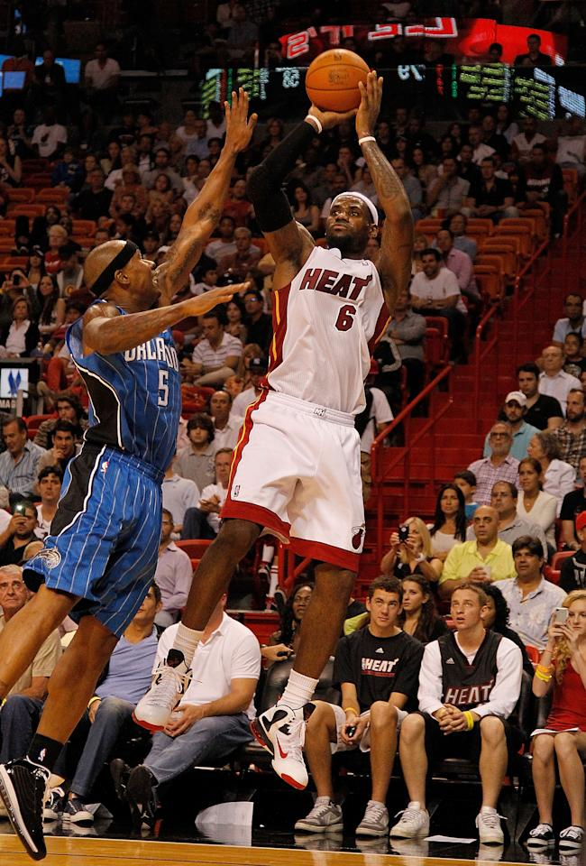 MIAMI, FL - DECEMBER 18: LeBron James #6 of the Miami Heat shoots over Quentin Richardson #5 of the Orlando Magic during a preseason game  at American Airlines Arena on December 18, 2011 in Miami, Florida. NOTE TO USER: User expressly acknowledges and agrees that, by downloading and or using this Photograph, user is consenting to the terms and condition of the Getty Images License Agreement. (Photo by Mike Ehrmann/Getty Images)