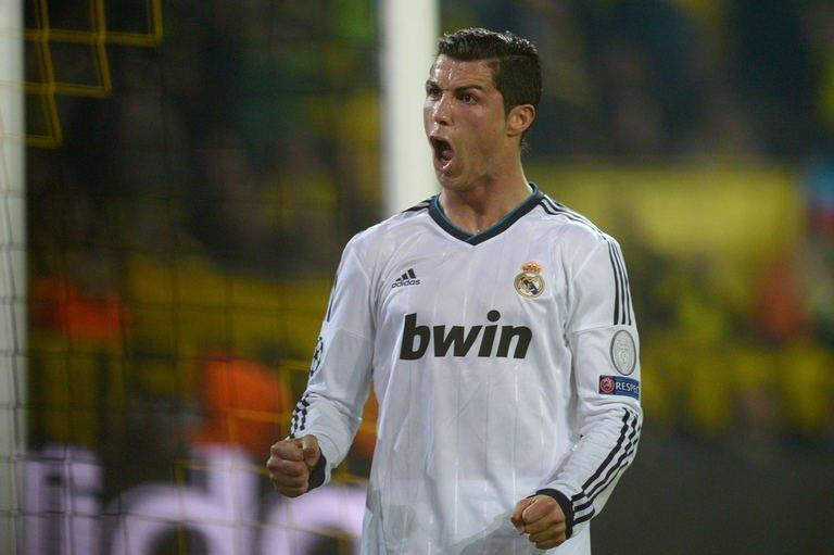 Real Madrid's forward Cristiano Ronaldo celebrates scoring during their UEFA Champions League semi-final first leg football match against Borussia Dortmund on April 24, 2013 in Dortmund, western Germany. Dortmund won 4-1