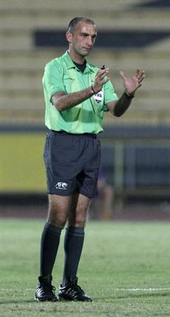 Referee Sabbagh gestures during the AFC Cup soccer match between Kuwait's Al Qadsia and Yemen's Al Saqr in Kuwait City