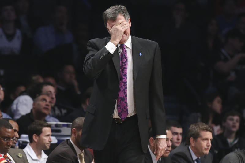 Houston Rockets head coach Kevin McHale reacts during the first half of their NBA basketball game against the Brooklyn Nets at the Barclays Center, Tuesday, April 1, 2014, in New York. The Nets defeated the Rockets, 105-96