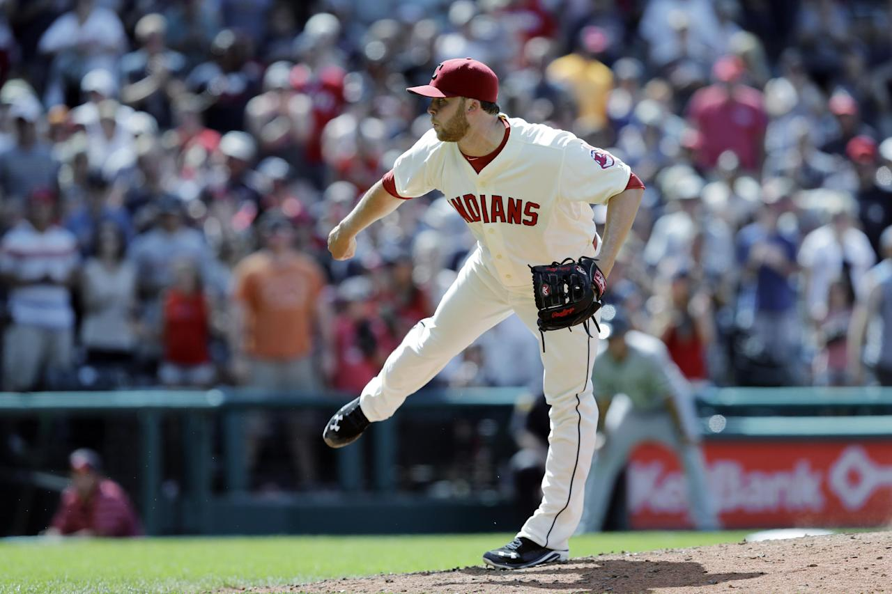 Cleveland Indians relief pitcher Cody Allen follows through on a pitch against the Chicago White Sox in a baseball game Sunday, July 13, 2014, in Cleveland. (AP Photo/Mark Duncan)