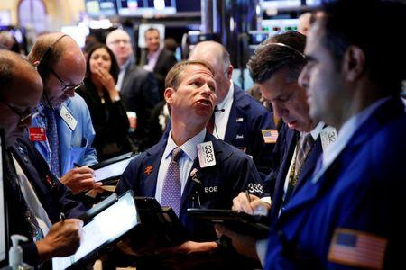 US stocks open slightly lower after weak retail sales