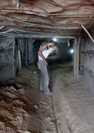 A Palestinian stands inside a smuggling tunnel under the Gaza-Egypt border in Rafah. Egypt's closure of scores of cross-border smuggling tunnels has affected the flow of goods into Gaza but has not dealt the knockout blow widely expected by traders and officials