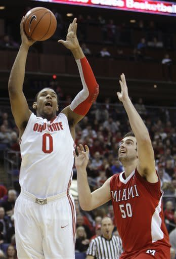 Ohio State's Jared Sullinger, left, shoots over Miami (Ohio)'s Drew McGhee during the first half of an NCAA college basketball game Thursday, Dec. 22, 2011, in Columbus, Ohio. (AP Photo/Jay LaPrete)