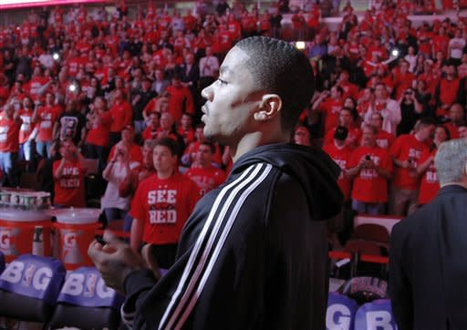Injured Chicago Bulls star Derrick Rose prepares to bring out the game ball before Game 2 in an NBA basketball first-round playoff series against the Philadelphia 76ers, in Chicago on Tuesday, May 1, 2012. The 76ers won 109-92 to even the series at a game apiece. (AP Photo/Daily Herald, Steve Lundy) MANDATORY CREDIT  TV OUT  MAGS OUT