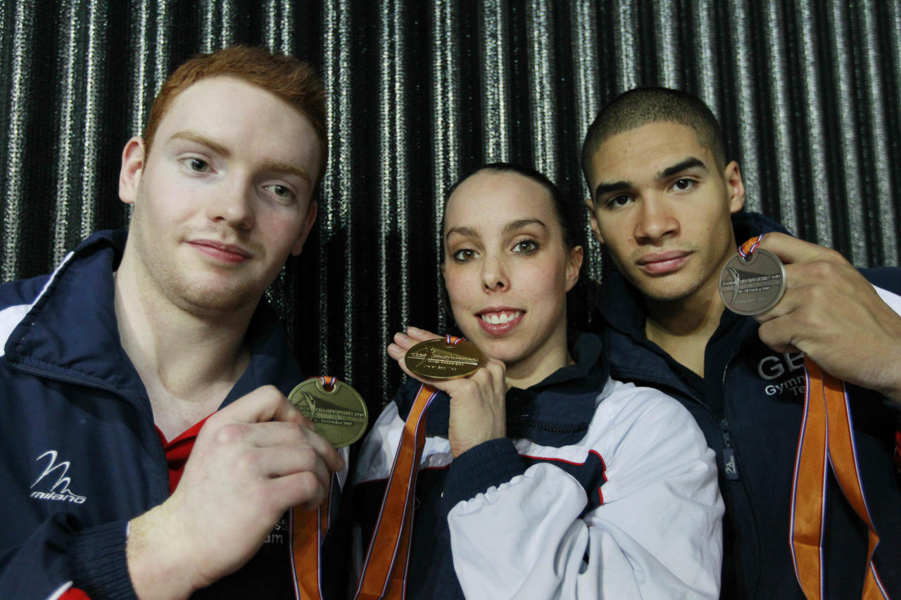 Britain's Daniel Purvis, bronze medal on the floor, Elizabeth Tweddle, gold medal on the uneven bars, and Louis Smith, silver medal on the pommel horse, left, to right, pose with their medals at the World Championships Gymnastics in Rotterdam, Netherlands, Saturday Oct. 23, 2010.