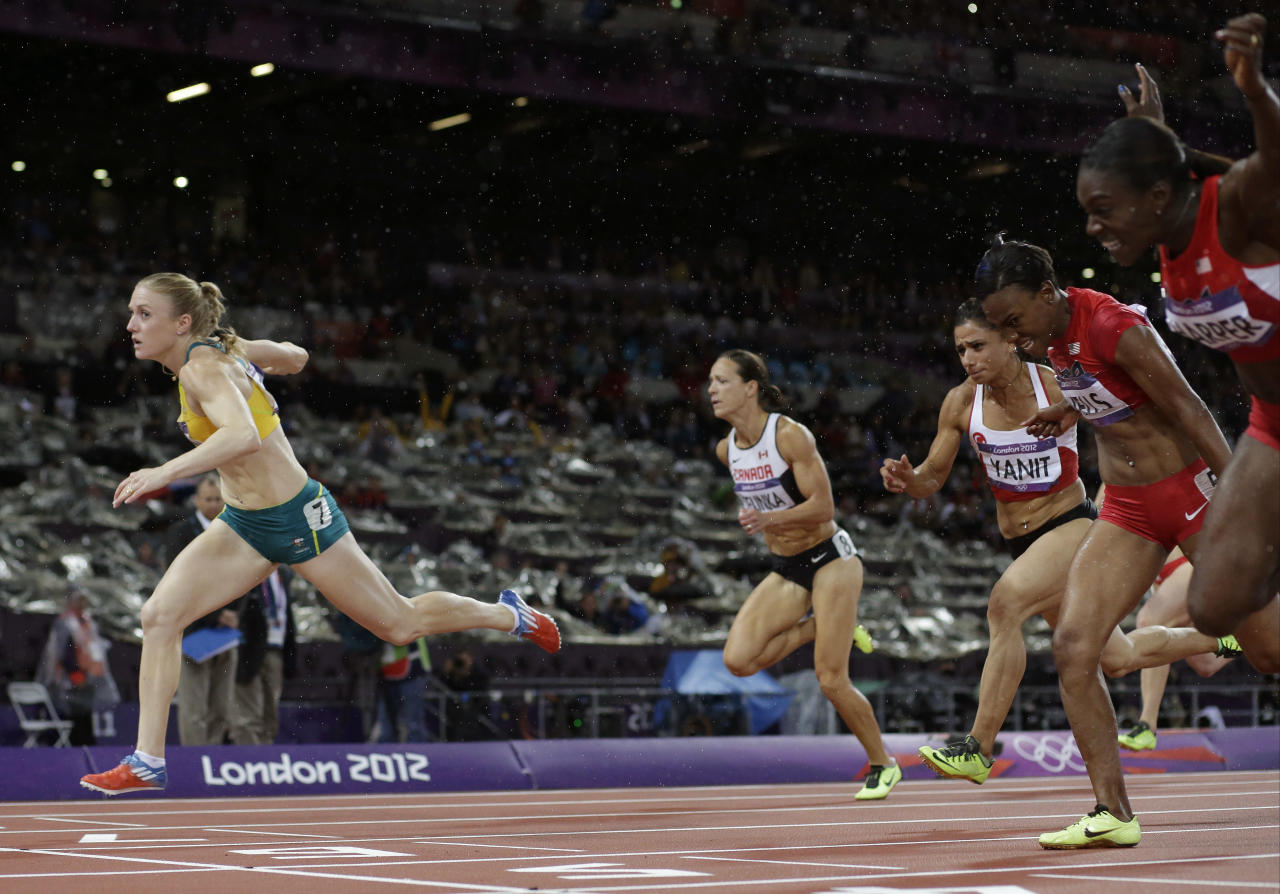 Australia's Sally Pearson, left, crosses the finish line to win gold ahead of United States' Dawn Harper, right, United States' Kellie Wells, second from right, Canada's Jessica Zelinka, second from left, and Turkey's Nevin Yanit in the women's 100-meter hurdles finalduring the athletics in the Olympic Stadium at the 2012 Summer Olympics, London, Tuesday, Aug. 7, 2012. (AP Photo/David J. Phillip )