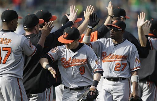 Wieters hits 2 homers in Orioles' 9-5 win over A's