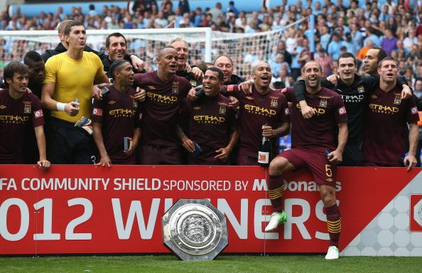 BIRMINGHAM, ENGLAND - AUGUST 12:  Manchester City celebrate after their victory during the FA Community Shield match between Manchester City and Chelsea at Villa Park on August 12, 2012 in Birmingham, England.  (Photo by David Rogers/Getty Images)