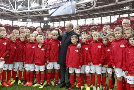 Russian President Putin talks to young soccer players during a visit to Spartak's stadium Otkrytie Arena in Moscow