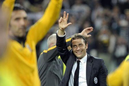 Juventus' Conte celebrates after winning the Serie A championship at the end of their match against Atalanta at the Juventus stadium in Turin