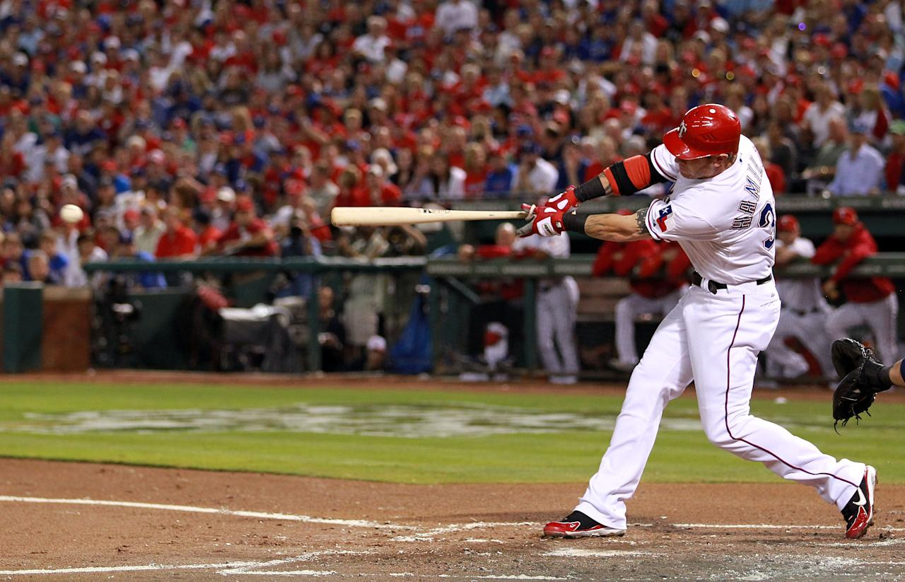 ARLINGTON, TX - OCTOBER 23:  Josh Hamilton #32 of the Texas Rangers hits an RBI double in the first inning during Game Four of the MLB World Series against the St. Louis Cardinals at Rangers Ballpark in Arlington on October 23, 2011 in Arlington, Texas.  (Photo by Ronald Martinez/Getty Images)