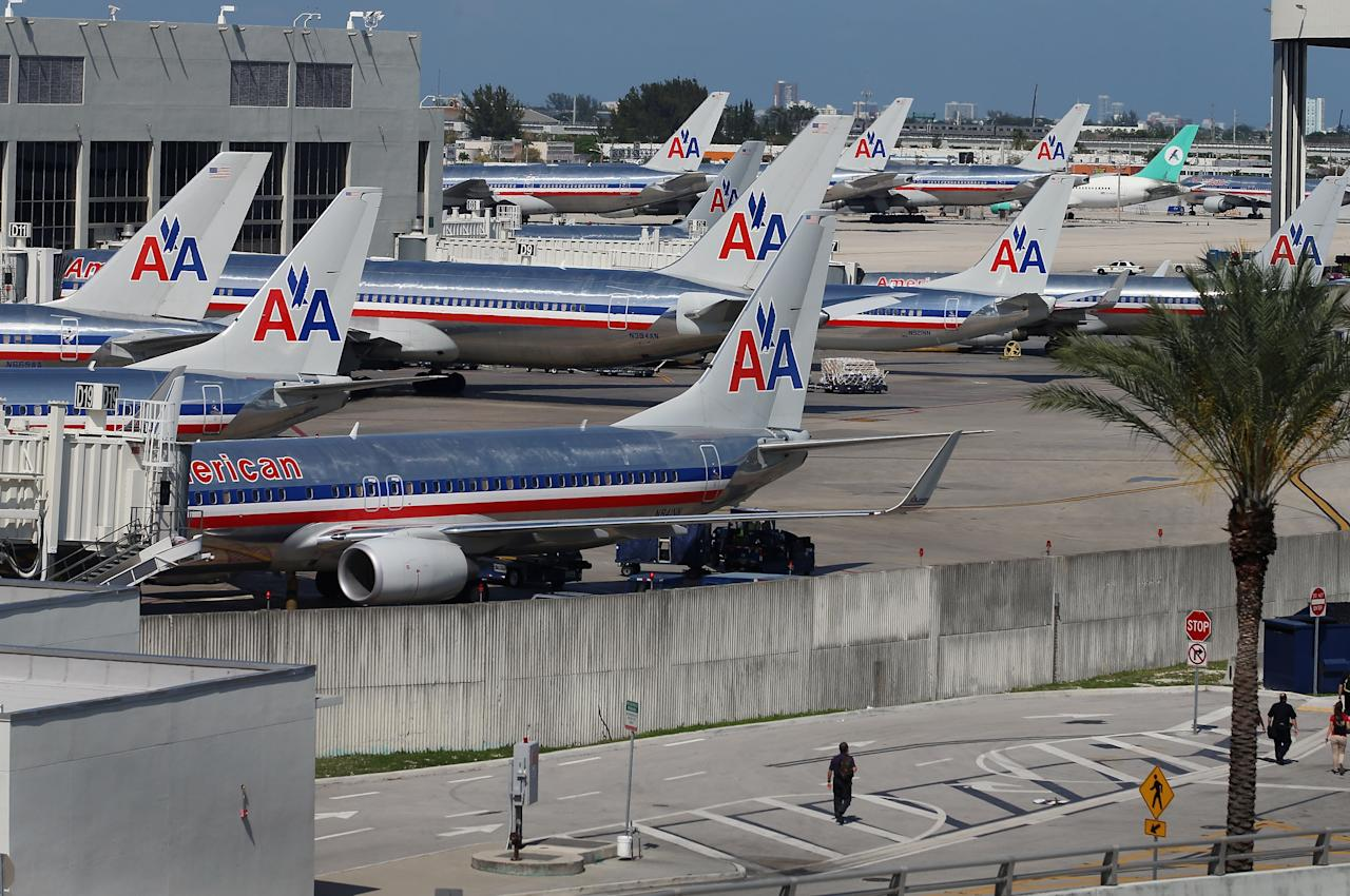 MIAMI, FL - APRIL 16:  American Airlines planes are seen at their gates at Miami International Airport on April 16, 2013 in Miami, Florida. Thousands of American Airlines travelers became stranded today when the airline was forced to ground all its flights after a nationwide problem with its computer systems  (Photo by Joe Raedle/Getty Images)