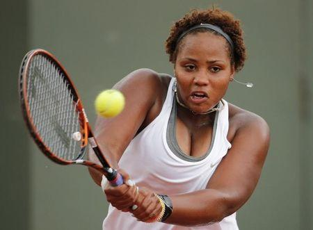 Taylor Townsend of the U.S returns a backhand to Carla Suarez Navarro of Spain during their women's singles match at the French Open tennis tournament at the Roland Garros stadium in Paris