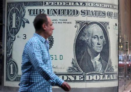 Dollar tumbles to seven-week low on Trump uncertainty