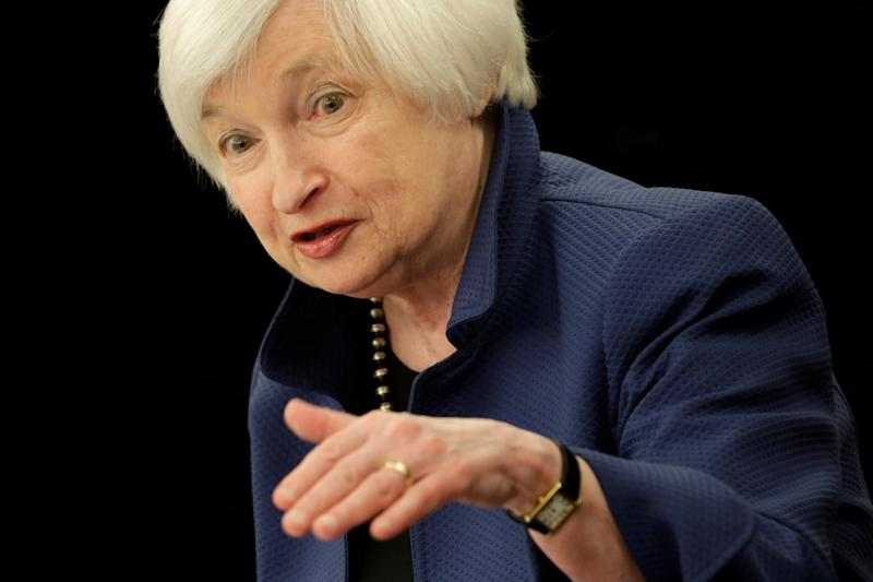 USA  dollar squeezed by cautious Fed