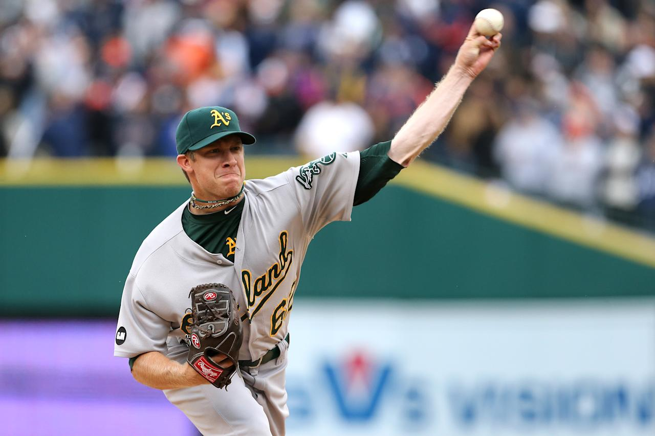 DETROIT, MI - OCTOBER 07:  Sean Doolittle #62 of the Oakland Athletics throws a pitch against the Detroit Tigers during Game Two of the American League Division Series at Comerica Park on October 7, 2012 in Detroit, Michigan.  (Photo by Leon Halip/Getty Images)