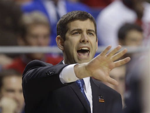 Butler head caoch Brad Stevens reacts in the first half of a third-round NCAA college basketball tournament game against Marquette, Saturday, March 23, 2013, in Lexington, Ky.  (AP Photo/John Bazemore)