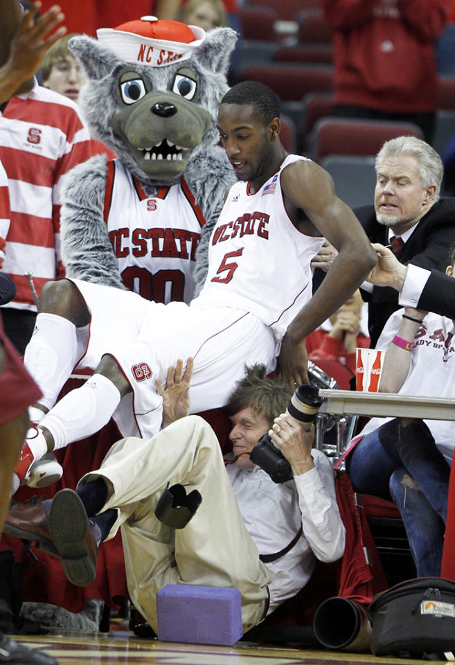 N.C. State's C.J. Leslie (5) falls over U.S. Presswire's Bob Donnan after chasing a loose ball during the second half at the RBC Center in Raleigh, North Carolina, Sunday, March 6, 2011. (Ethan Hyman/Raleigh News & Observer/MCT via Getty Images)